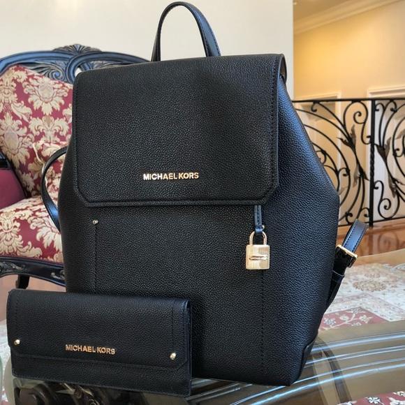 a0f8e6aad576 Michael Kors Hayes backpack wallet weekend sale. M 5b7e2bc7fb3803edf7b111f2